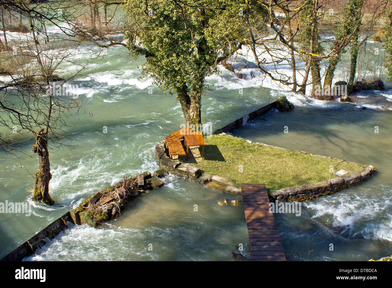 Resting place in pure nature on small river island in village Rastoke in Croatia - Stock Image