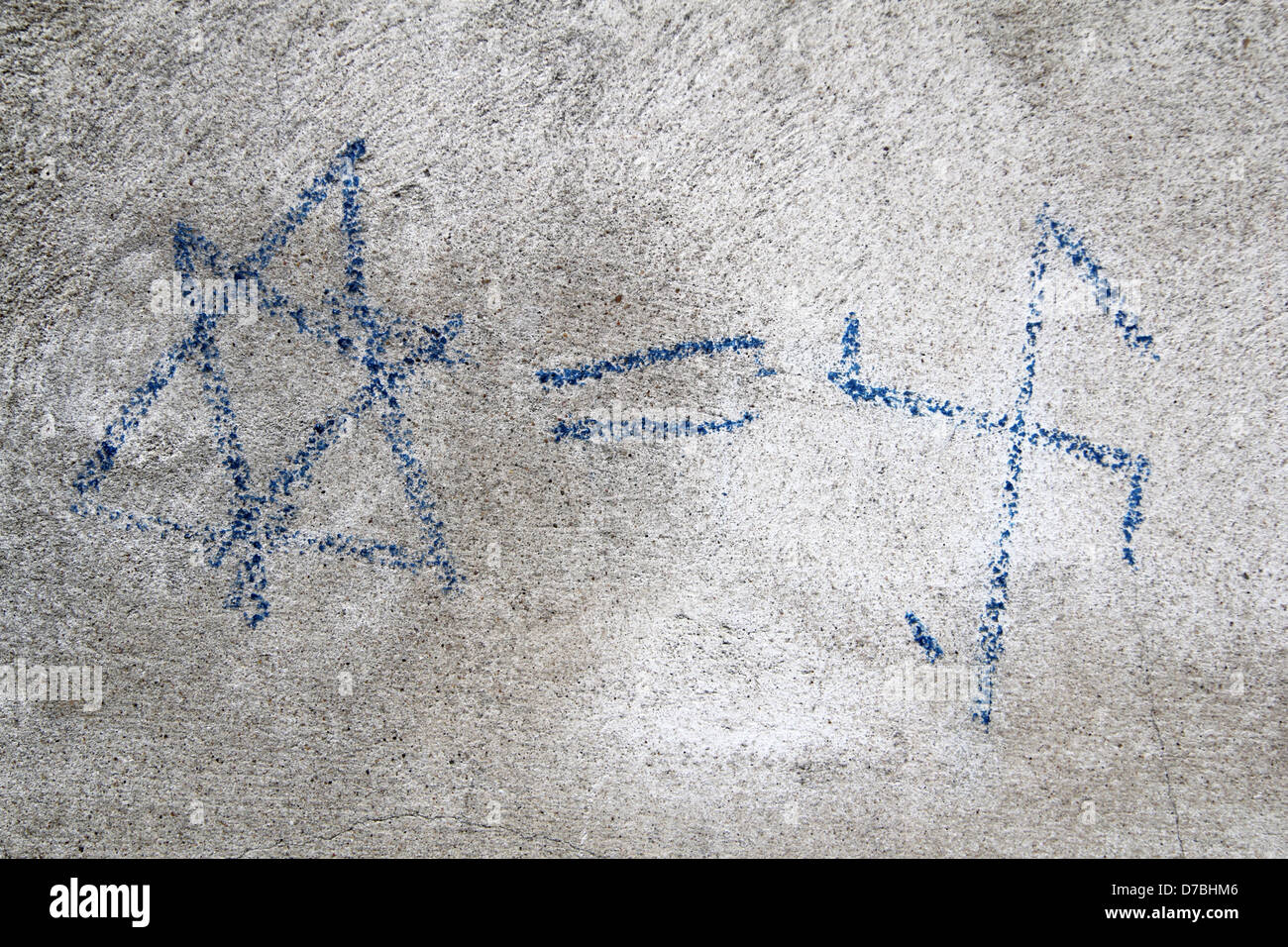 Anti-Semite graffiti in Krakow, Poland, equalizing a Nazi symbol with a Jewsih one - Stock Image