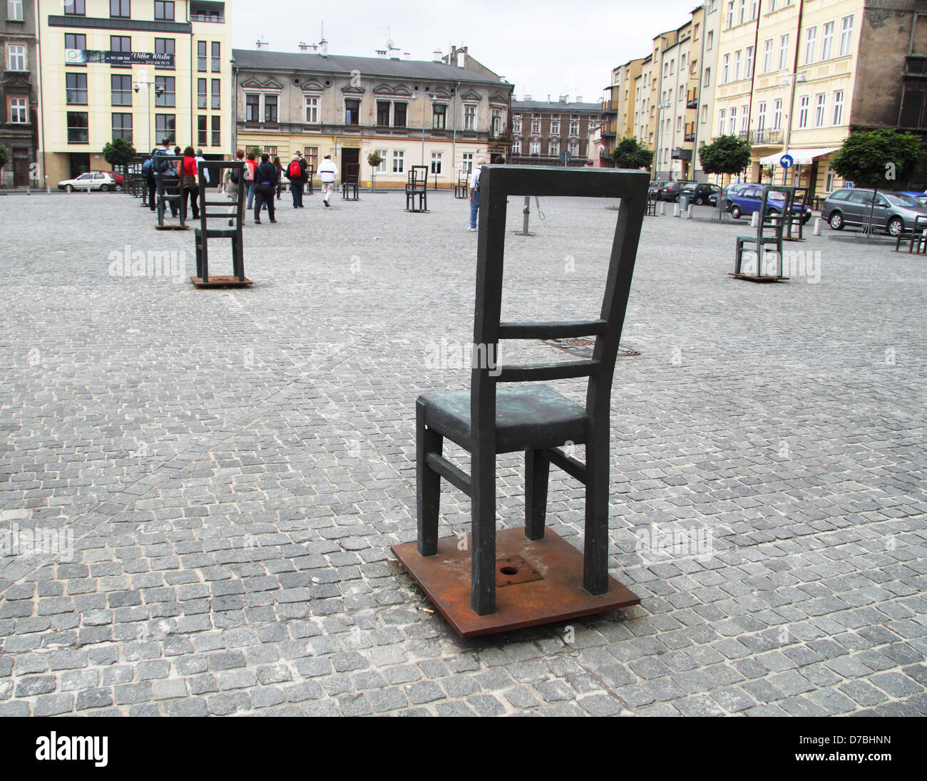 Monumental metal chairs at Zgody Sq. memorializing the victims of Krakow ghetto, Poland - Stock Image