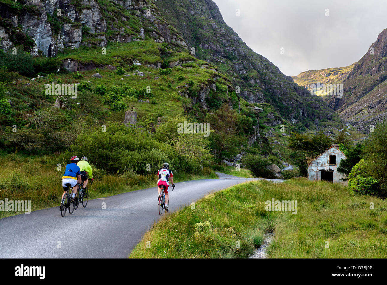 Cycling at the Gap of Dunloe , Co. Kerry - Stock Image