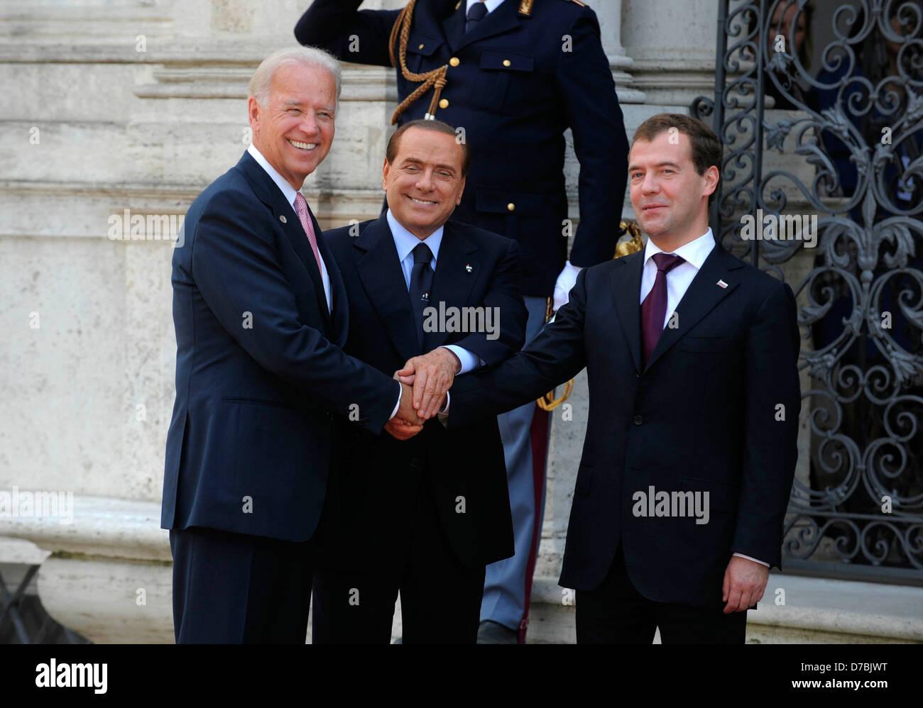 US Vice President Joe Biden meets Italian Prime Minister Silvio Berlusconi and Russian President Dmitry Medvedev Stock Photo