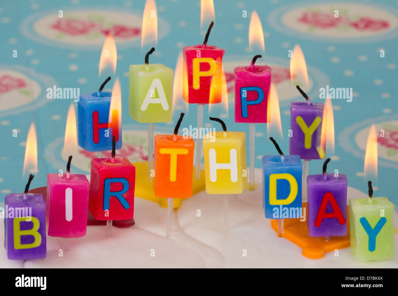 Happy Birthday Candles On Cake With Blue And Floral Background