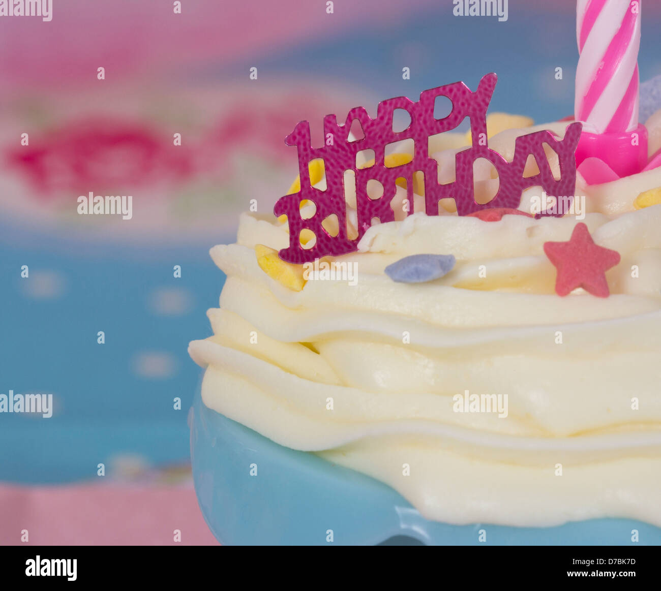 Happy Birthday Cupcake with white icing blue case and pink candle