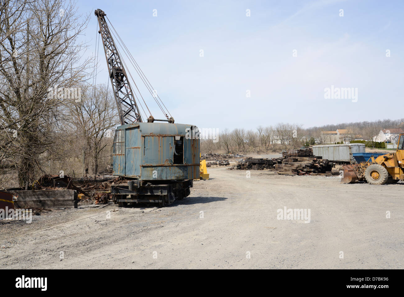old construction crane sitting abandoned in a junkyard - Stock Image