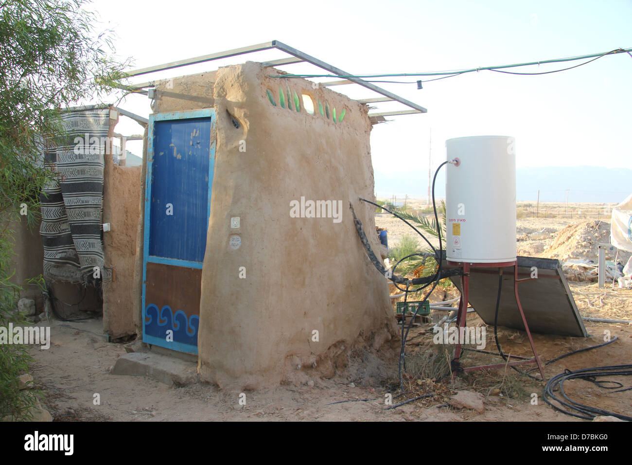 Solar powered hot water shower in Lotan, the ecological kibbutz in the Arava, south of Israel - Stock Image
