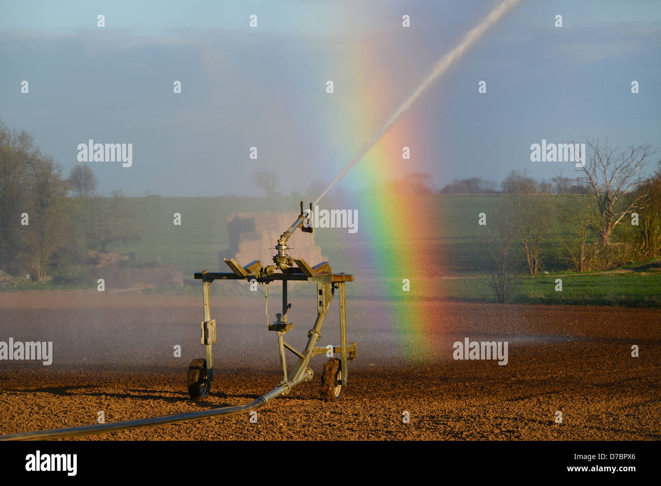 water cannon irrigating seeds in field during drought spell in hot summer south milford yorkshire uk - Stock Image