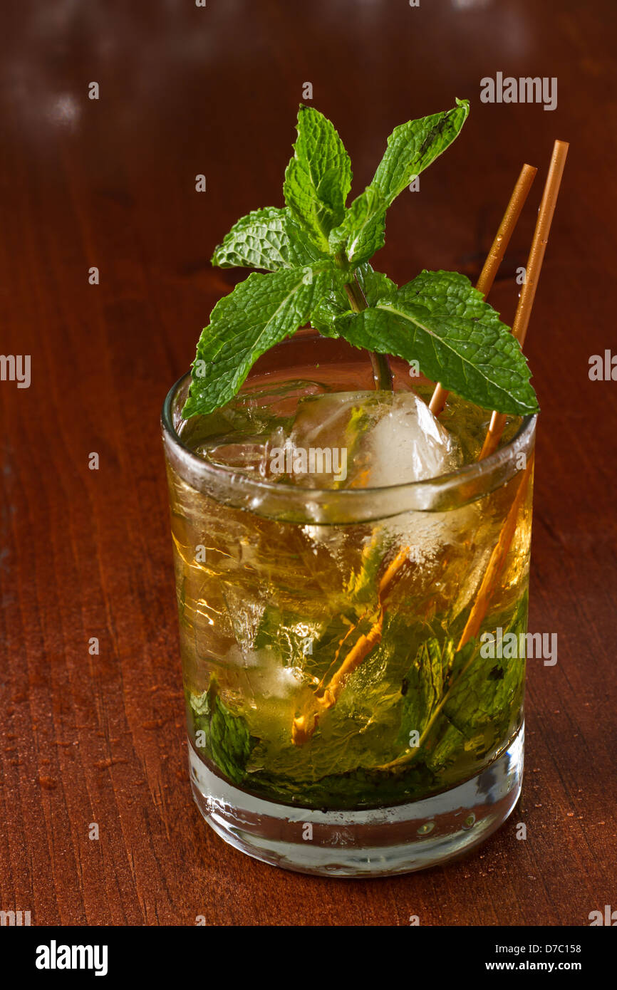 close up of a mint julep served on the rocks and garnished with fresh green mint on top, Kentucky derby drink - Stock Image