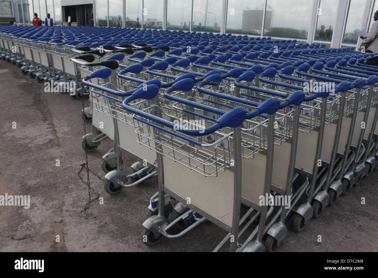 Baggage Trolley chained together at the front of remodeled Murtala Muhammed International Airport Terminal, Lagos, Stock Photo