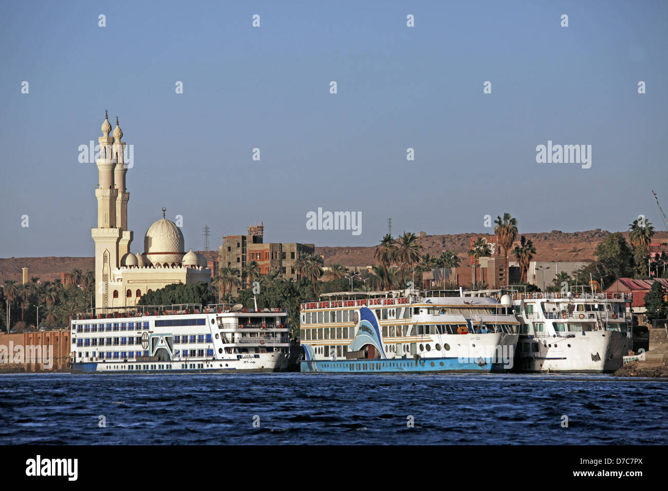 CRUISE LINERS & MOSQUE RIVER NILE ASWAN EGYPT 10 January 2013 - Stock Image
