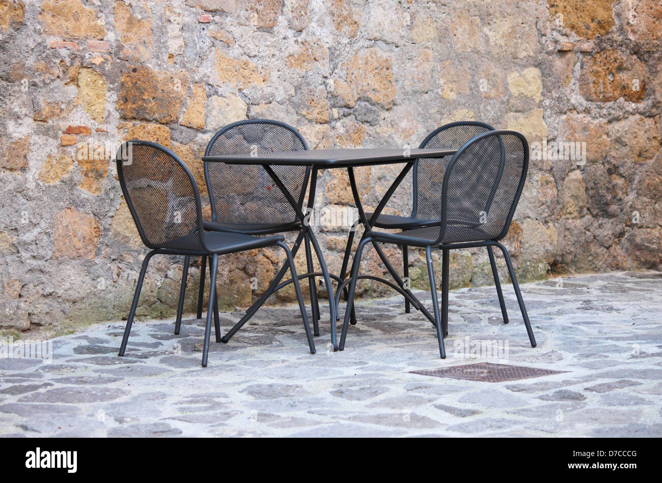 Iron Table And Chairs On Outdoors Cafe In Mediterranean Europe