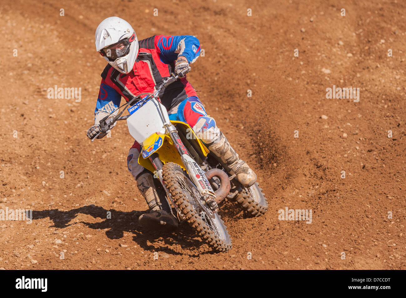 A motocross bike scrambler riding in the mud in the Uk - Stock Image