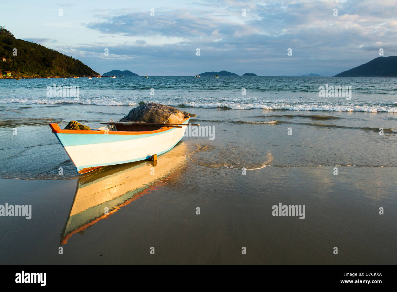 Fishing boat on the sand at Pantano do Sul Beach. - Stock Image