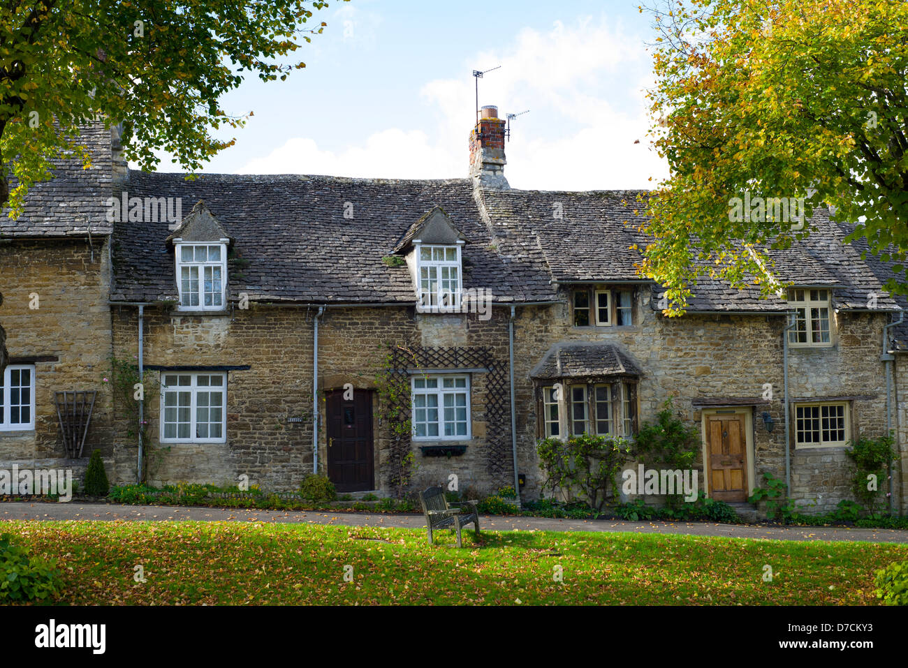 View of Burford in the Cotswolds, showing the cottages at the top end of the high street, Oxfordshire, England - Stock Image