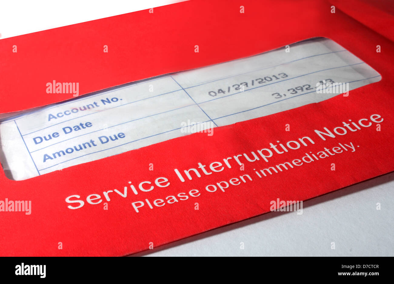 Red envelope containing reminder memo to consumers. - Stock Image