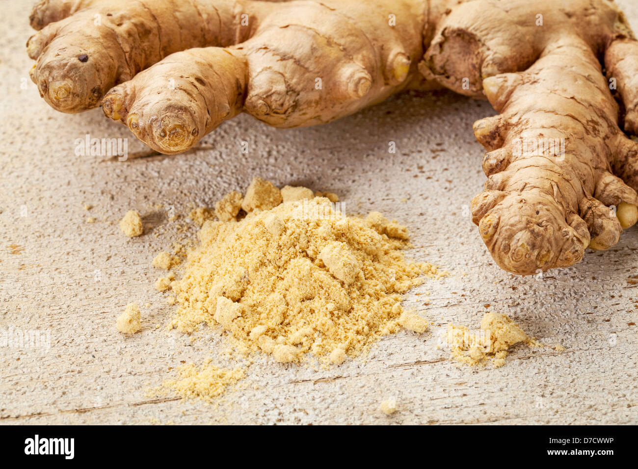 ginger root and powder on a rustic white painted barn wood background - Stock Image