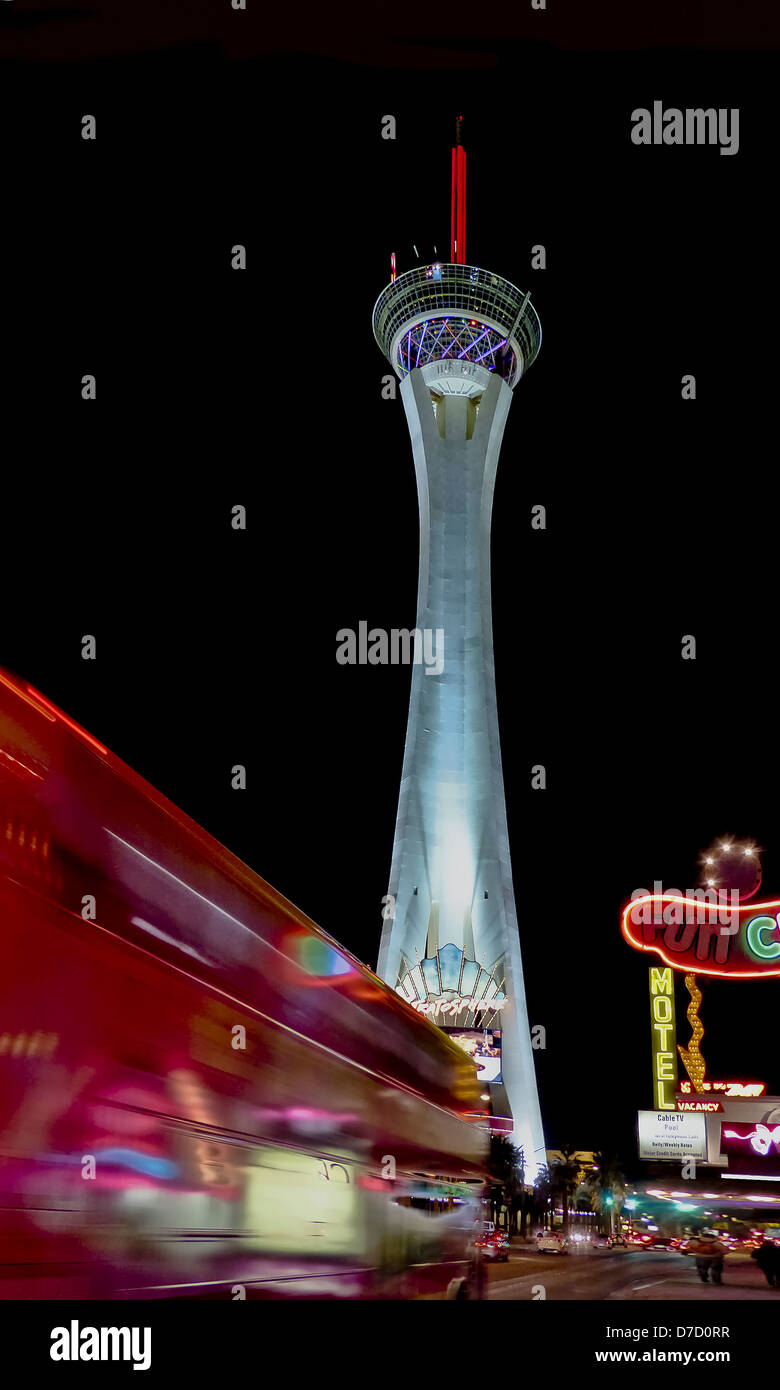 The Stratosphere Casino at night from Las Vegas Blvd. - Stock Image