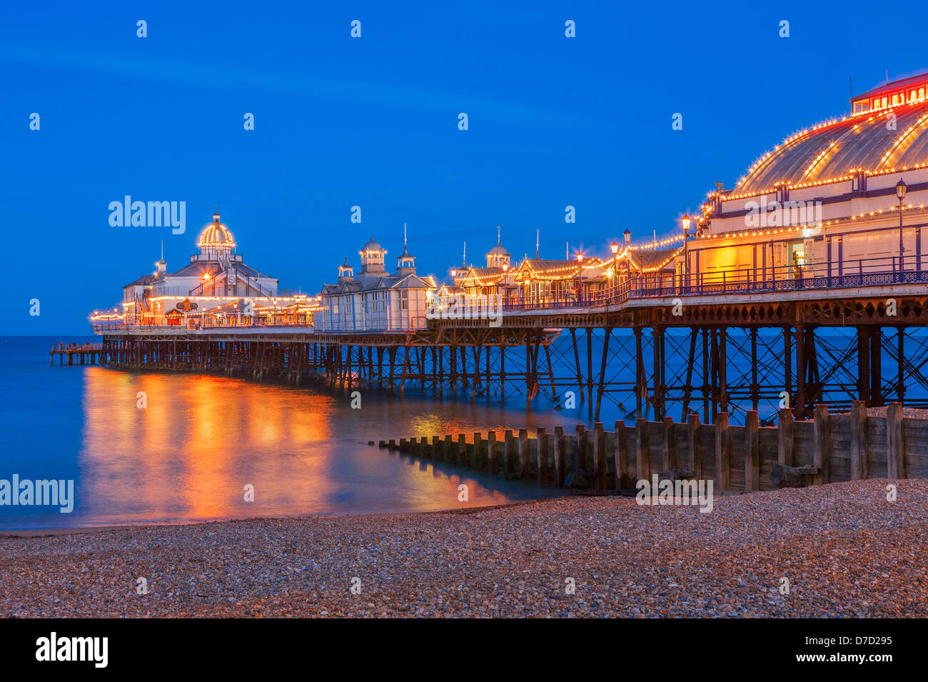 Eastbourne pier illuminated at Twilight - Stock Image
