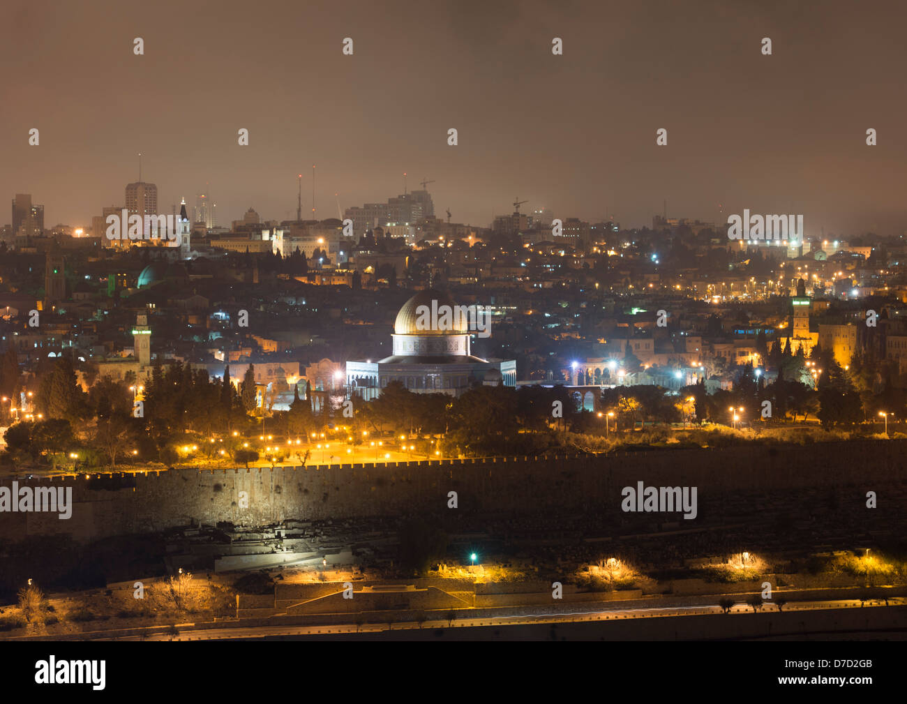 The Jerusalem skyline at night showing the golden dome of the Islamic Dome of the Rock, viewed from the Mount of - Stock Image