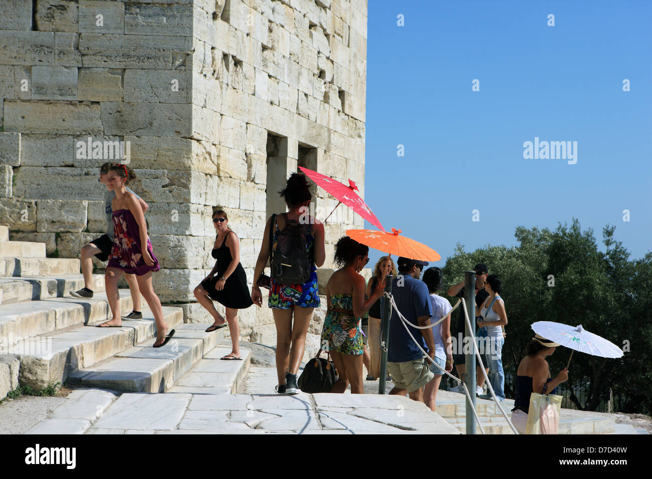 Bright coloured sunshades shielding visitors from the extreme heat and sun at the Acropolis in Athens Greece - Stock Image