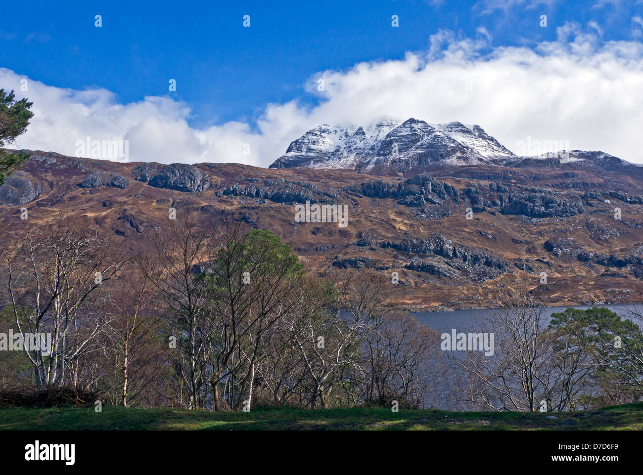 Changing April weather over Loch Maree in in Wester Ross Highland Scotland with mountain Slioch - Stock Image