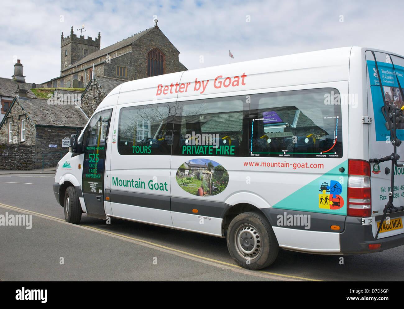 Mountain Goat minibus parked in Hawkshead village, Lake District National Park, Cumbria, England UK - Stock Image