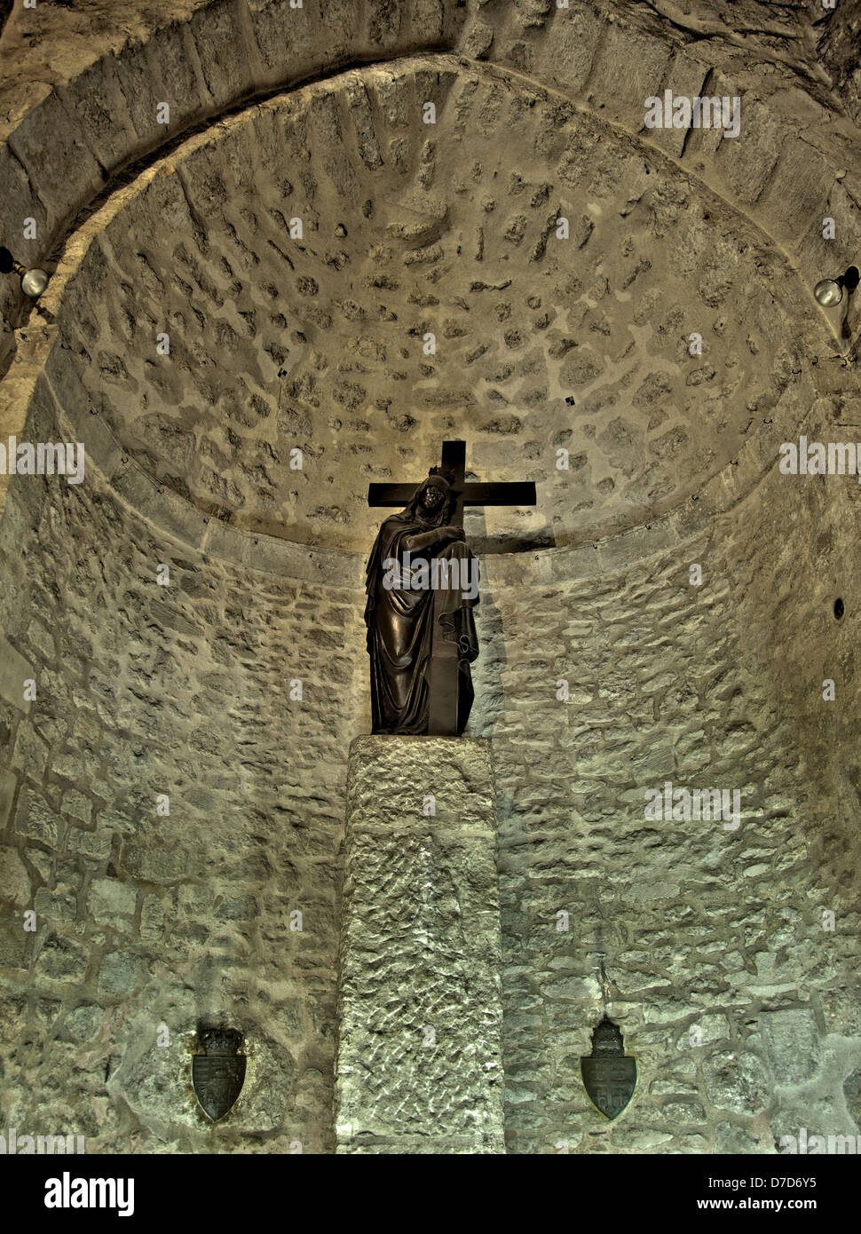 An altar in the Church of the Holy Sepulchre depicting Maria Magdalene holding the cross. - Stock Image