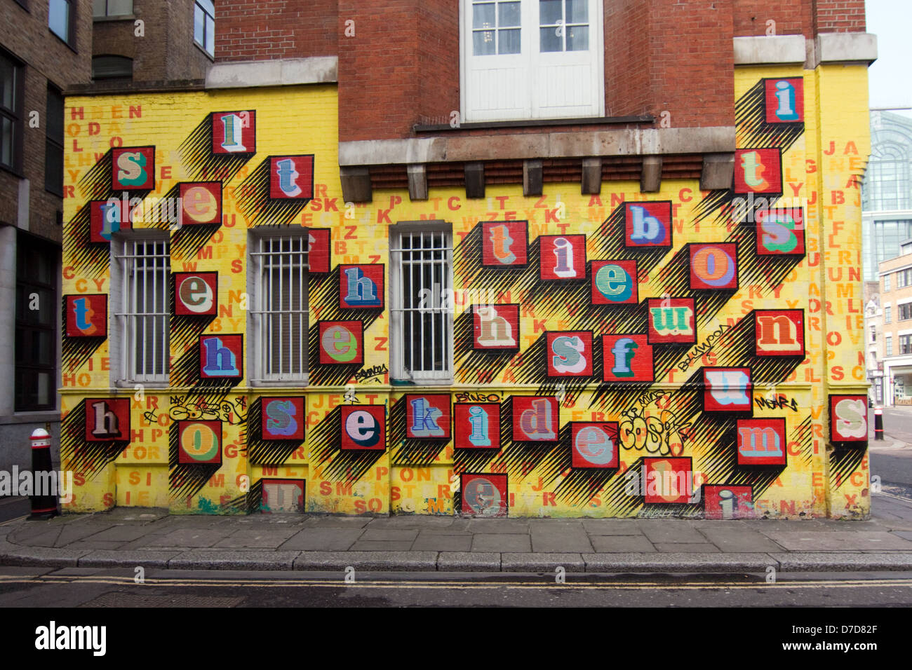 Ben Eine streetart in Shoreditch London .Ben Eine is famous for his use of different  fonts. - Stock Image