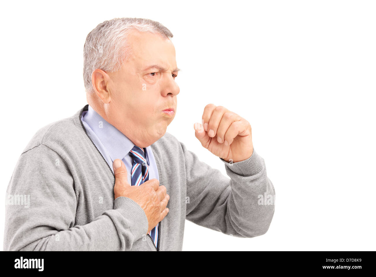 A mature gentleman coughing because of pulmonary disease isolated on white background - Stock Image