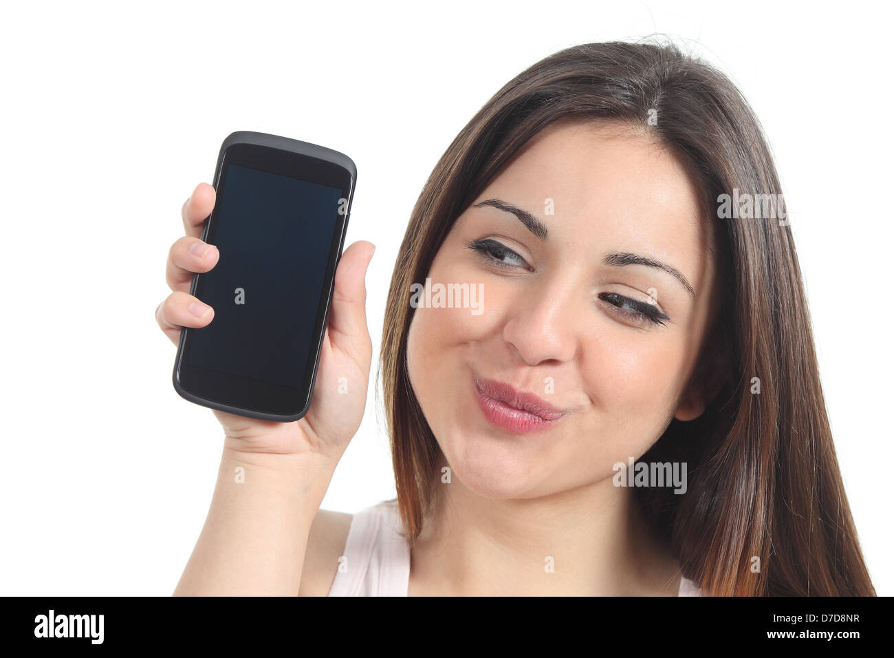 Sweet woman showing a black mobile phone screen isolated on a white background Stock Photo