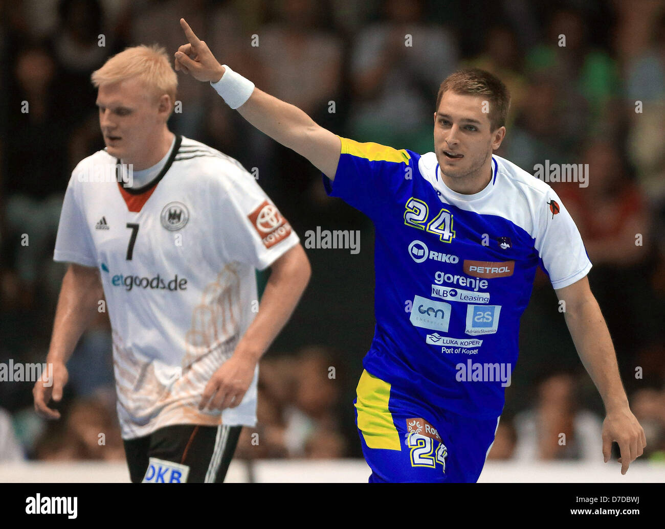 Slovenian Gasper Marguc gestures after he scores during the handball match Germany vs Slovenia in the GETEC Arena - Stock Image