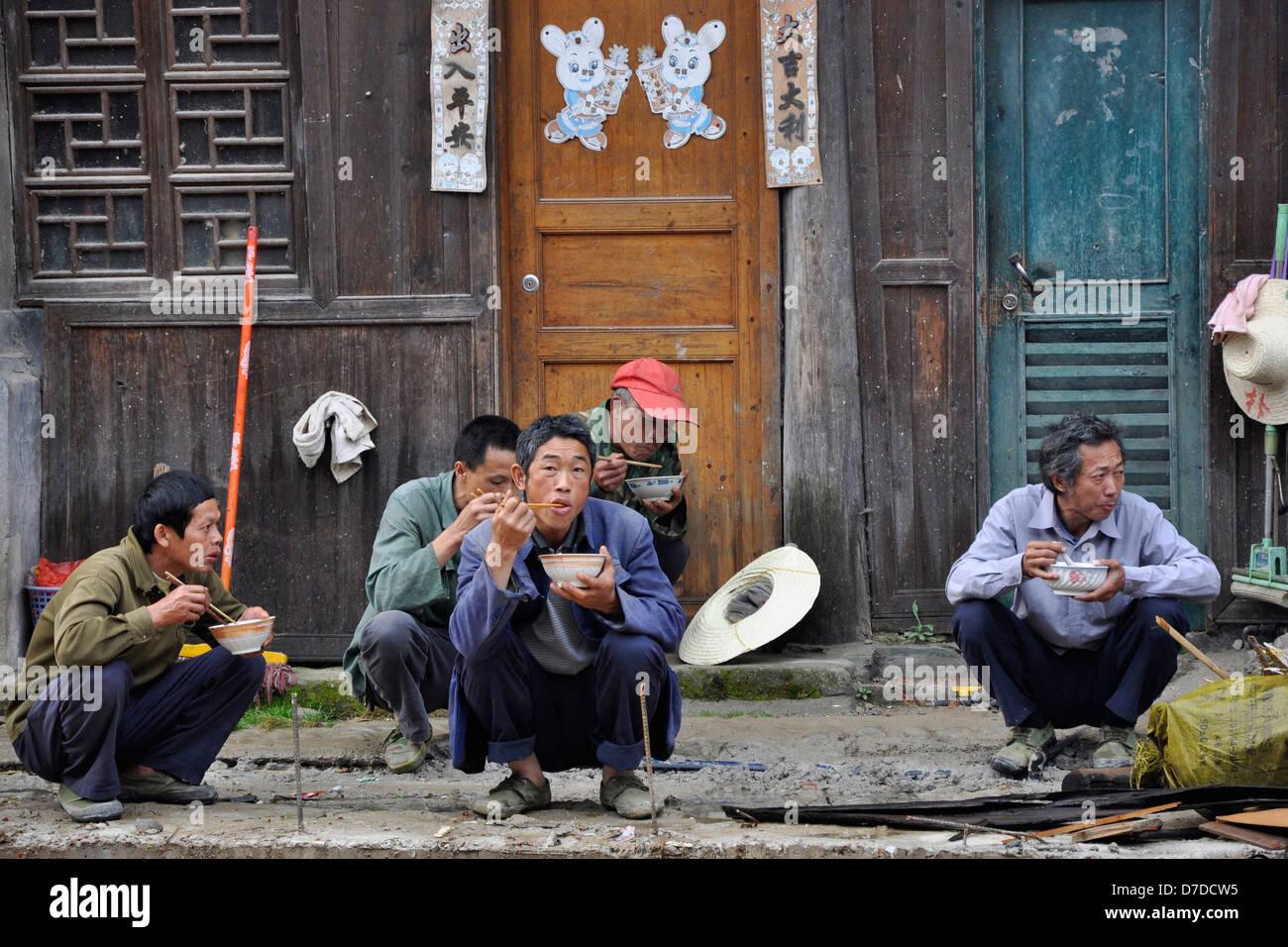 China, Guizhou province, Zhaoxing village, lunch time Stock Photo
