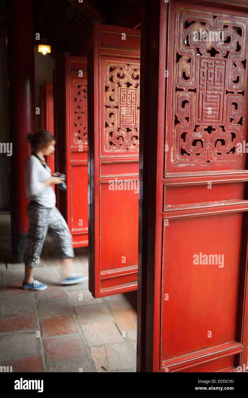 A tourist at a temple on Hoam Kiem Lake in Hanoi, Vietnam - Stock Image