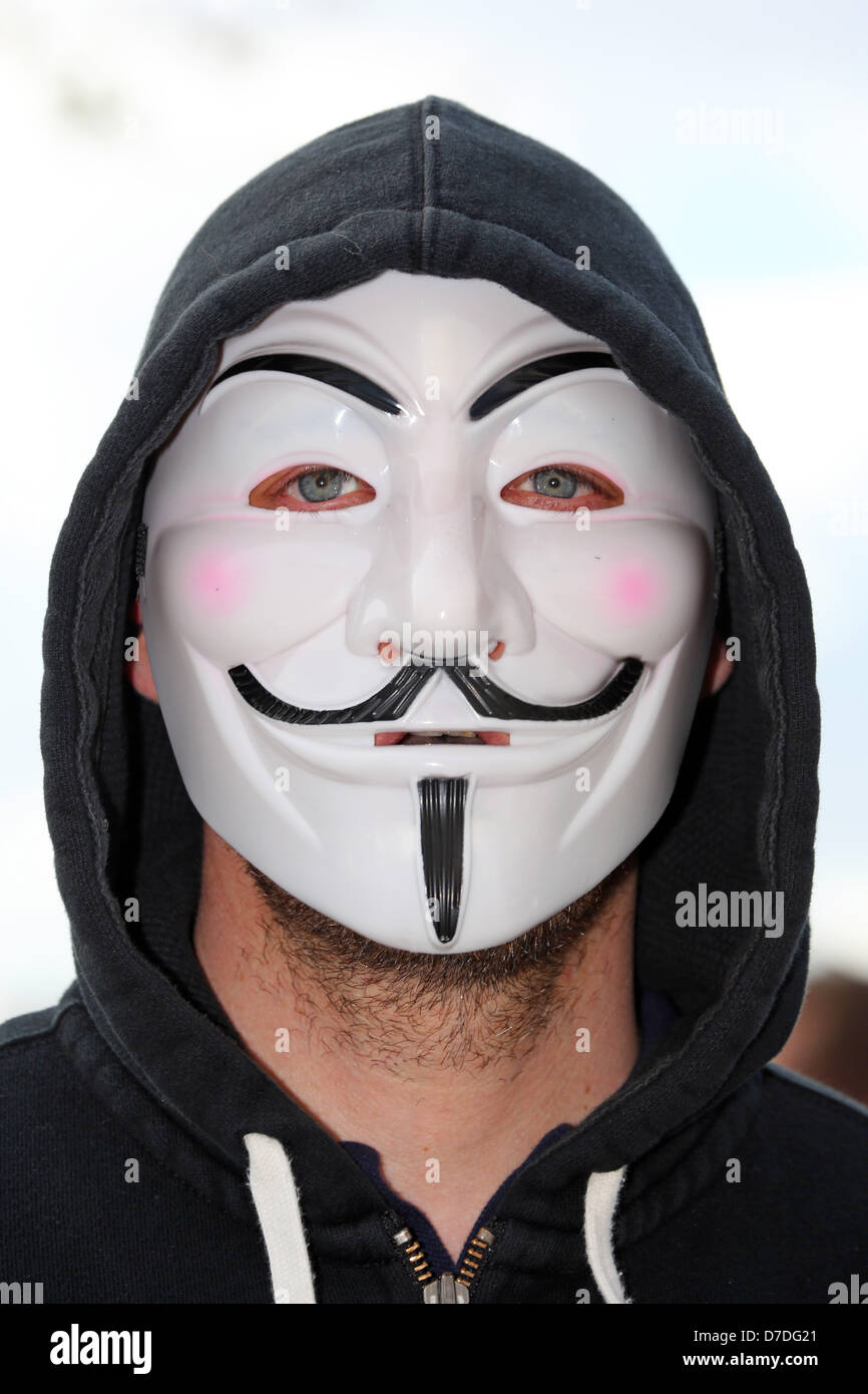London, UK. 4th May 2013. Protestor wearing mask at the Anonymous UK anti-austerity demonstration, London, England. - Stock Image