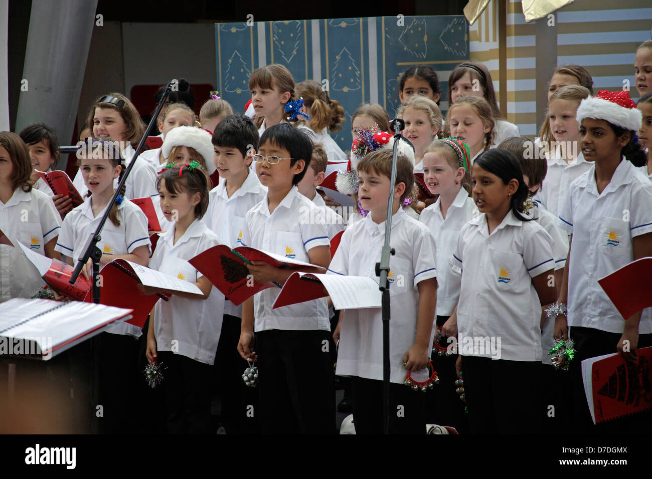 Multicultural childrens choir singing christmas songs in Brisbane, Queensland, Australia - Stock Image
