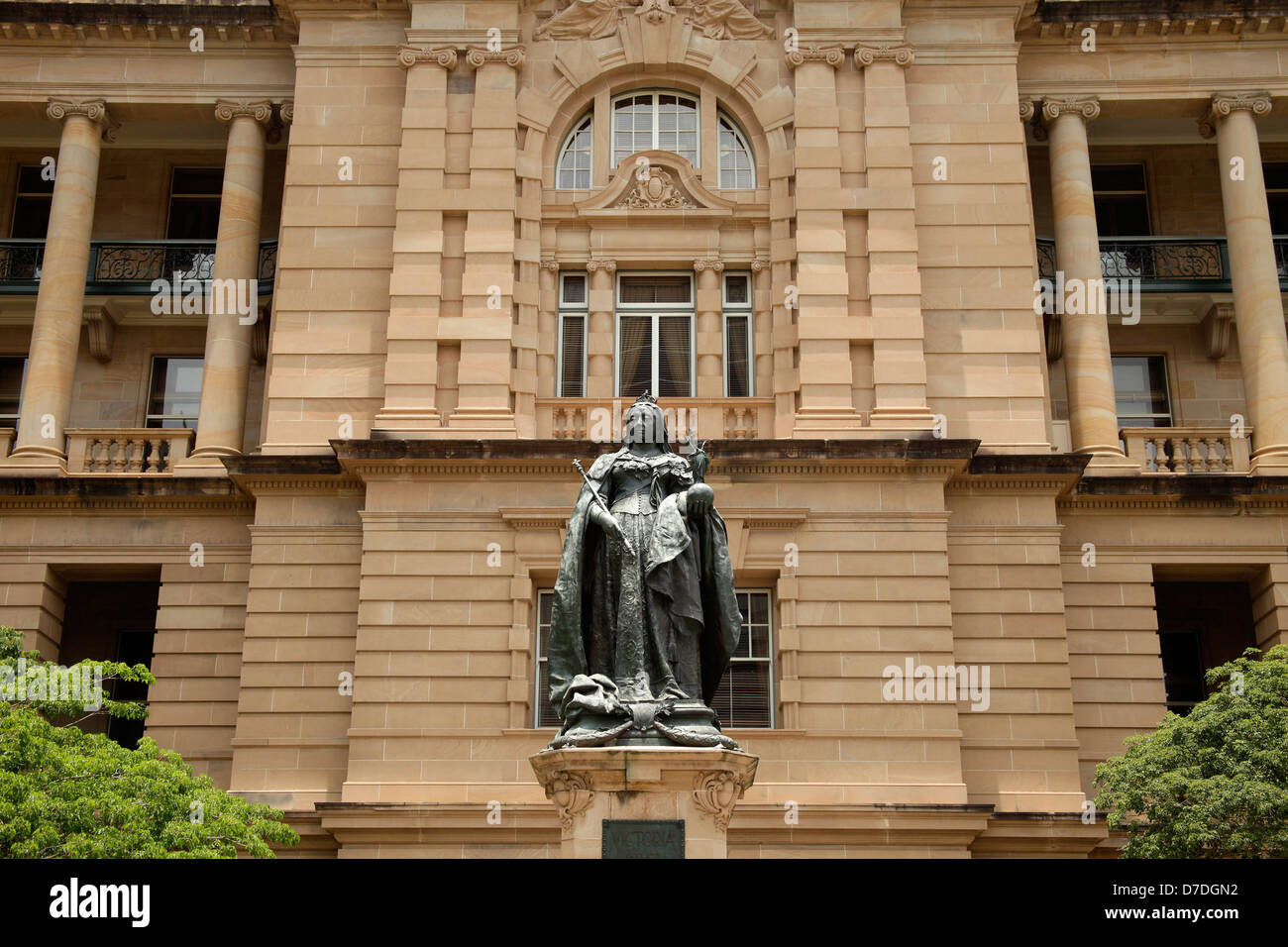 Statue of Queen Victoria and the Lands Administration Building in Queens Gardens in Brisbane, Queensland, Australia - Stock Image