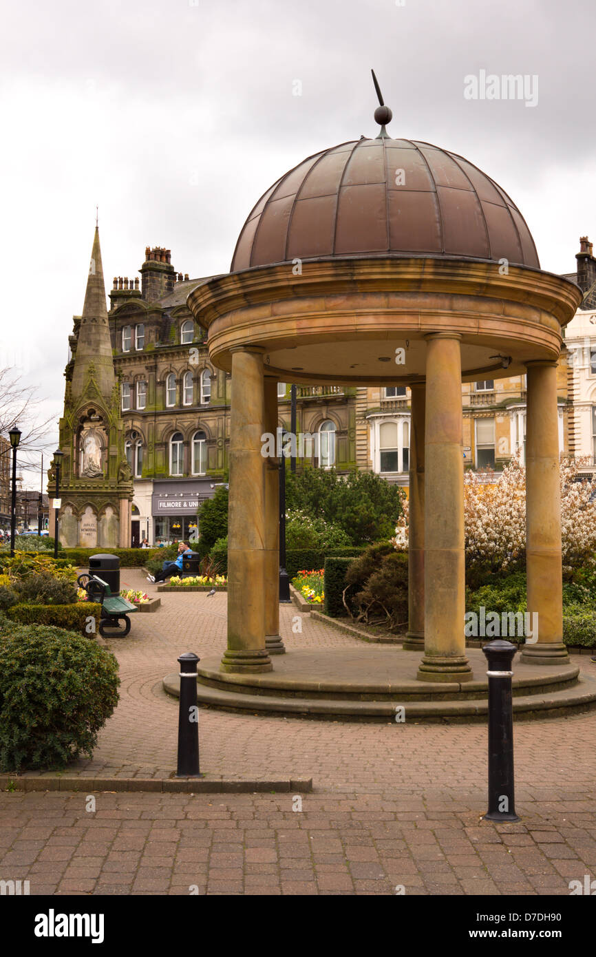 Bandstand and Memorial in park setting, located at the Victoria shopping centre in Harrogate. - Stock Image