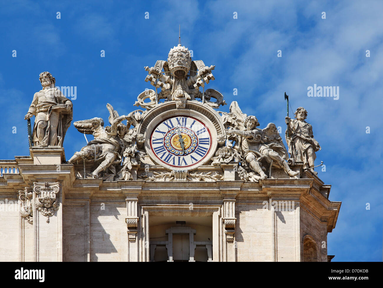 Clock with sculptures on facade of Saint Peter basilica. Vatican, Italy Stock Photo