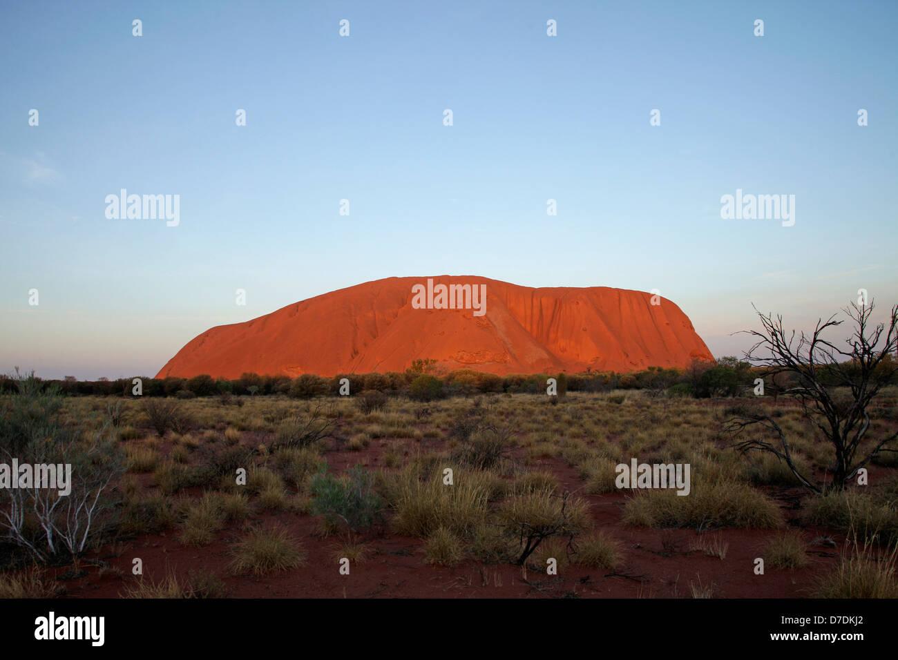 world-renowned sandstone formation Uluru or Ayers Rock , Northern Territory, Australia - Stock Image