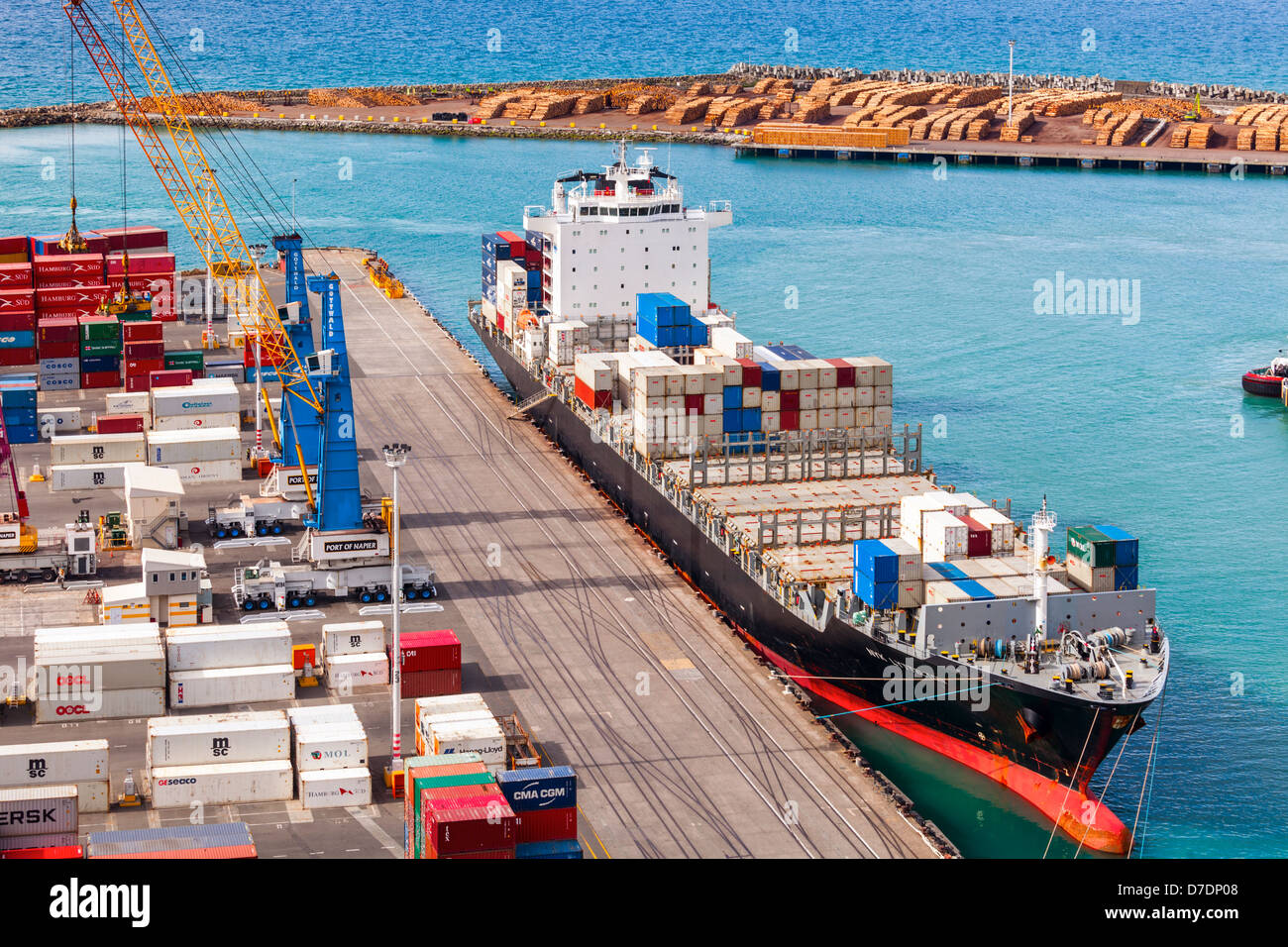 Container ship NYK Lyttelton at Napier Port, Hawke's Bay, New Zealand. Lots of containers on the dock... - Stock Image