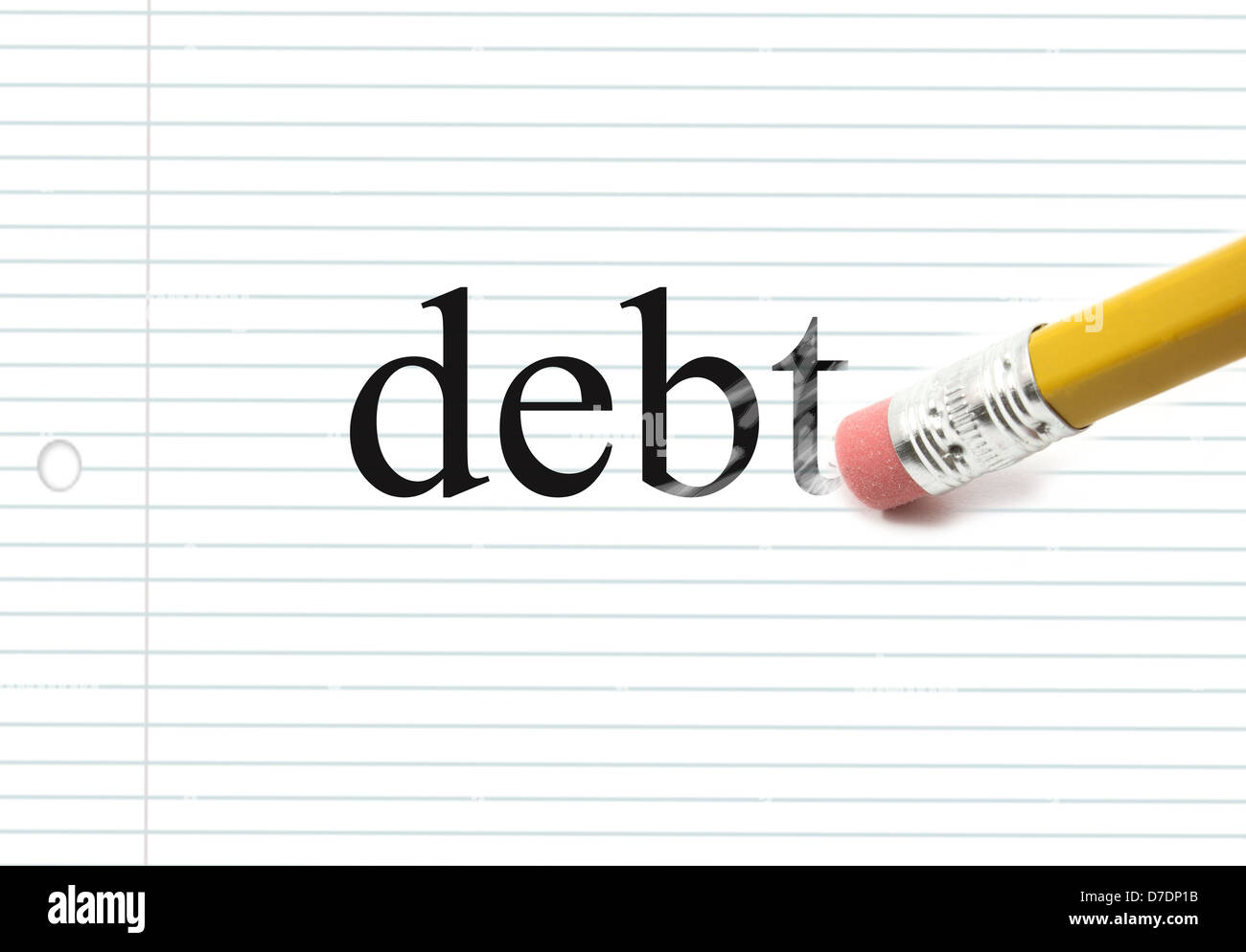 The word debt written on notebook paper with the end of a pencil erasing the black letters showing eraser marks - Stock Image
