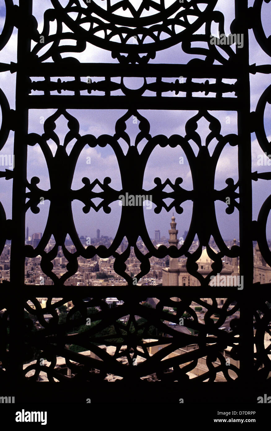 View of Cairo cityscape through cast Iron railings of Saladin or Salaḥ ad-Dīn Citadel a medieval Islamic fortification - Stock Image