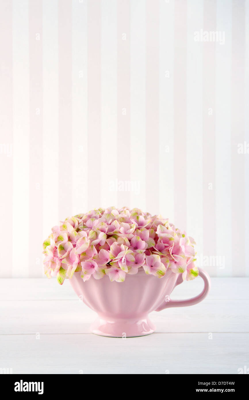 Pink Hydrangea Flowers In A Shabby Chic Mug On Pastel Vintage Background With Copy Space