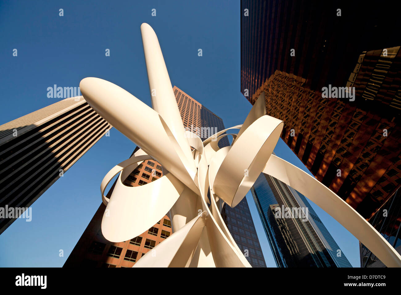 Worm's-eye view of Downtown Los Angeles skyscrapers and sculptur - Stock Image