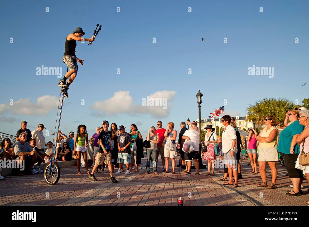 Street performers and spectators at Mallory Square in Key West, Florida Keys, Florida, USA - Stock Image