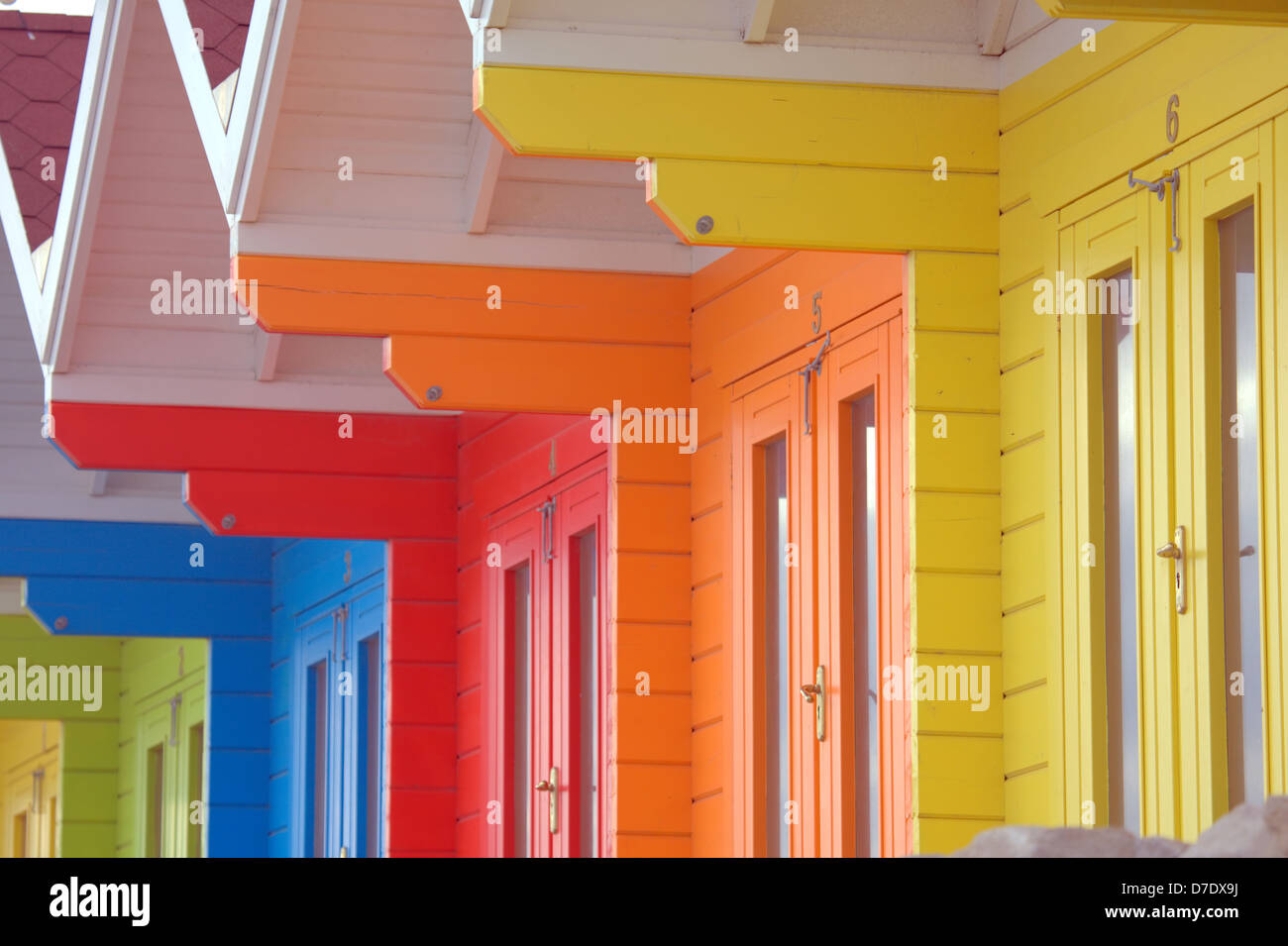 Colourful graphic pattern of beach huts. - Stock Image