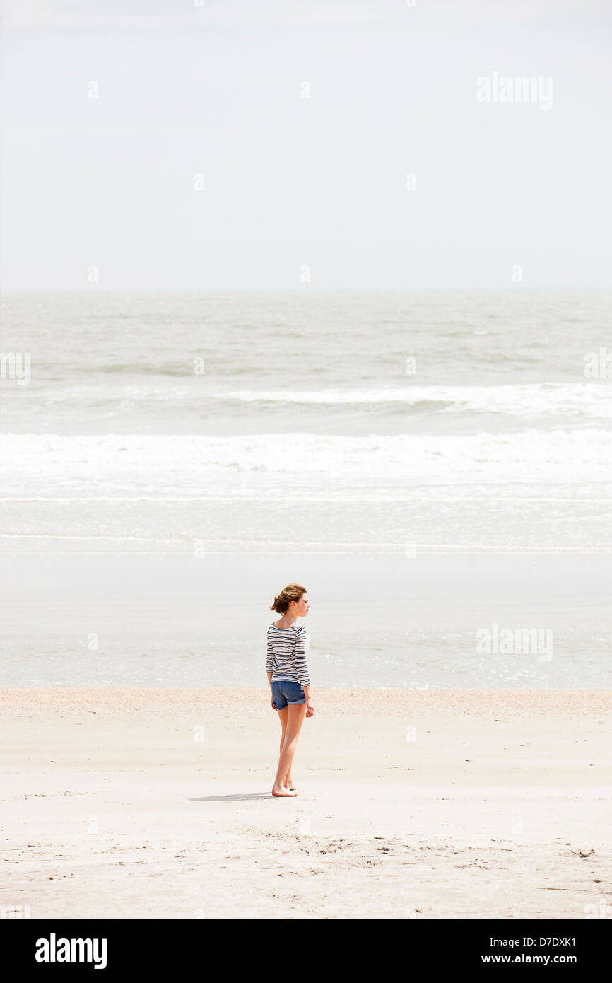 Girl looking at beach Stock Photo