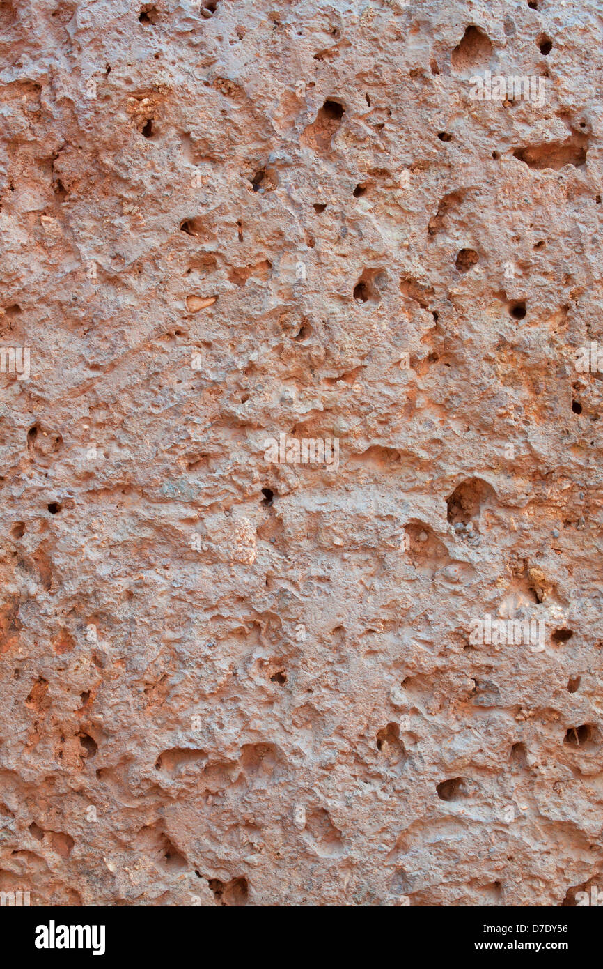 Ancient clay walls rough red clay porous. Stock Photo