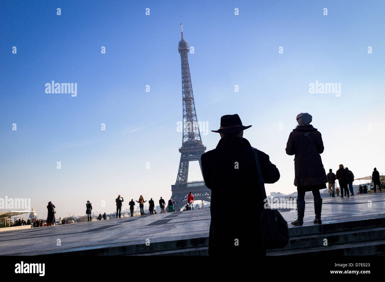 Tourists photographing The Eiffel Tower from Place du Trocadéro. - Stock Image