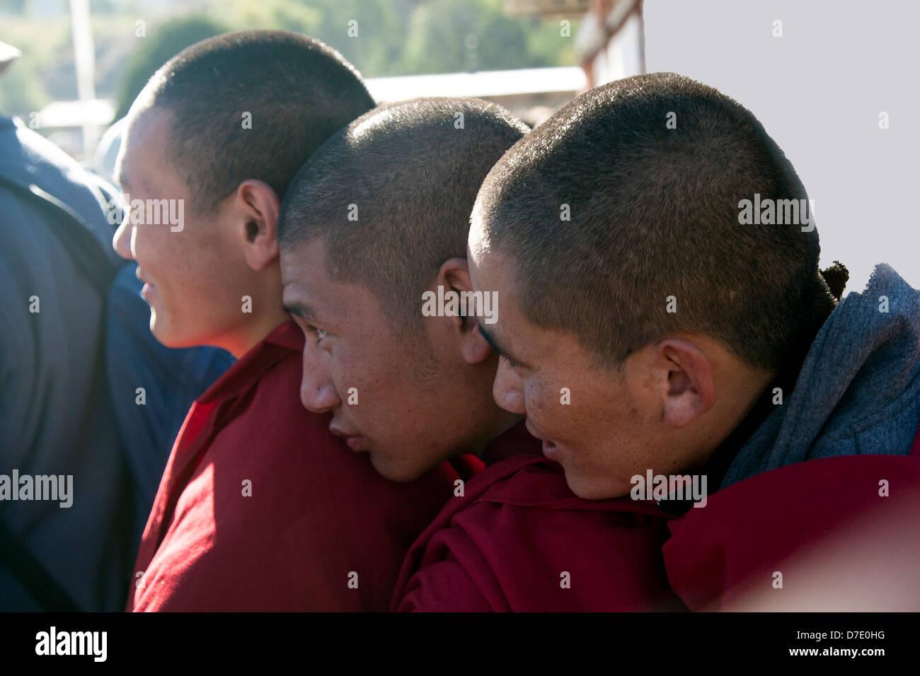 Buddhist monks enjoy a festival in Jakar, Bhutan. - Stock Image