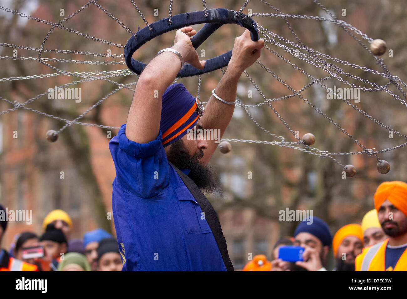 Manchester, UK. 5th May, 2013.  A Nihang or Sikh warrior performs 'Gatkha', a traditional form of martial arts. - Stock Image